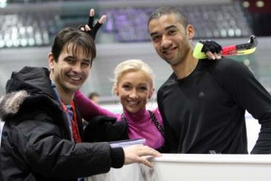 Aliona Savchenko and Robin Szolkowy with their coach, former Olympic bronze medalist Ingo Steur (far left). Photo by Wikipedia user David W. Carmichael.