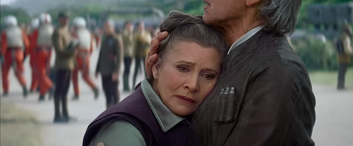 """Han Solo comforts Princess (now General) Leia Organa in """"The Force Awakens"""""""